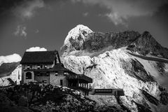 Alpine chalet. A chalet in the italian alps, in black and white stock photography