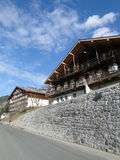 Alpine chalet in mountain valley Royalty Free Stock Photo