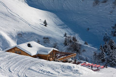 Alpine chalet. Winter time stock images