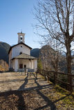 Alpine church in autumn landscape Royalty Free Stock Image
