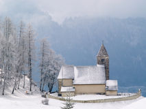 Alpine Church after snowfall. Alpine Church after morning snowfall in mountain village of Falera, Switzerland Royalty Free Stock Photography