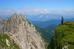 Alpine Climber. On the edge, above cliff Royalty Free Stock Photography