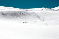 Alpine Climbers walking on high Altitude snowy Mountain Glacier Stock Photo