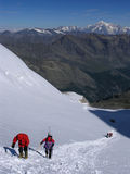Alpine climbing. With Mt. Blanc in background stock photos