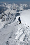 Alpine climbing. Alpine climber on a snow ridge Royalty Free Stock Image