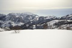 Alpine cloudscape in winter Royalty Free Stock Photos