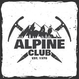Vintage typography design with ice axe, rock climbing Goats and mountain silhouette. Alpine club badge. Vector illustration. Concept for shirt or logo, print Stock Images