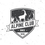 Vintage typography design with ice axe, rock climbing Goats and mountain silhouette. Alpine club badge. Vector illustration. Concept for shirt or logo, print Stock Photo