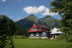 Alpine cottage Stock Photos