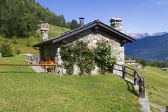 Alpine cottage Stock Photos