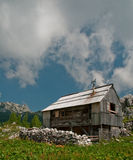 Alpine cottage in the mountains. Alpine cottage on a high alpine meadow in summer, Julian Alps royalty free stock photo