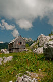 Alpine cottage in the mountains. Alpine cottage on a high alpine meadow in summer, Julian Alps Stock Images