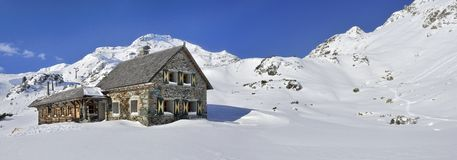 Alpine Cottage in Obertauern. The winter scenery with the alpine cottage in Austrian Alps Royalty Free Stock Image