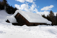 Alpine cottage in the winter Stock Image