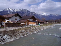 Alpine cottages by a river Stock Photo