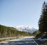 Alpine country road in the Austrian Alps - Stock Photo royalty free stock photography