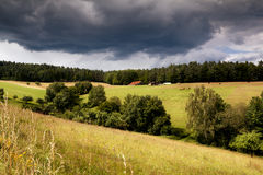 Alpine cow farm in mountains before storm Royalty Free Stock Images