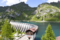 Alpine dam. Overview of the dam of Lake fedaia near the Marmolada mountain, in Italy Stock Photography