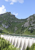 Alpine dam. Overview of the dam of Lake fedaia near the Marmolada mountain, in Italy Royalty Free Stock Photography