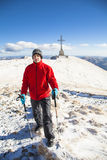 Alpine expedition to Caraiman Cross. Trekking in mountains during winter to Caraiman Cross in bucegi mountains, Romania Royalty Free Stock Images
