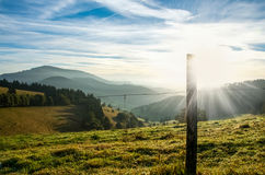Alpine fields sun rise Stock Photography