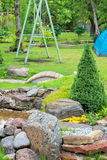 Alpine garden with green grass Royalty Free Stock Image