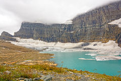 Alpine Glacier and Lake on a Cloudy Day Royalty Free Stock Image