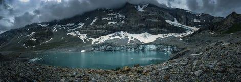 Alpine glacier lake in Swiss Alps - panoramic shot royalty free stock photos