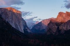 The Alpine Glow in Yosemite Valley. The alpine glow hits the top of Yosemite Valley National Park, California Stock Image