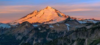 Alpine Glow on Mt. Baker. The morning alpine glow lights up the face of Mt. Baker in Washington State Stock Image