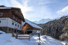 Alpine guest house Bergheim Fotsch and mountain panorama with snow in winter in Stubai Alps Stock Photos