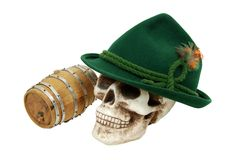 Alpine hat on skull next to an oak barrel Royalty Free Stock Photo
