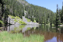 Alpine High Lake on Fish Creek Mountain. Upper Rocky Moraine meets High Lake just below summit of Fish Creek Mountain Mount Hood National Forest Wilderness Royalty Free Stock Photos