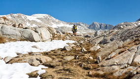 Alpine Hiking. Hikers on their way to a high mountain pass in the Sierra Nevada, California, USA Royalty Free Stock Image