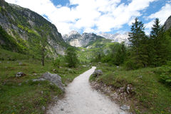 Alpine Hiking Trail. Rugged hiking trail in obersee, Berchtesgaden, Germany Royalty Free Stock Photo