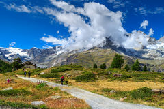 Alpine hiking trails with hikers,Zermatt,Switzerland,Europe Royalty Free Stock Image
