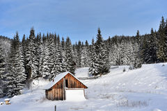 Alpine house covered with snow in the mountains Royalty Free Stock Photography