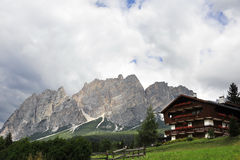 Alpine house in Dolomites. Stock Photo