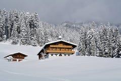 Winter under Kaisergebirge, Tirol, Austria. Alpine house in picturesque winter scenery under Kaisergebirge in Tirol - Austria Stock Image
