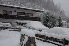 Alpine house at snowfall. Germany. Royalty Free Stock Photo