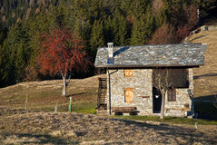 Alpine hut in autumn landscape Royalty Free Stock Images
