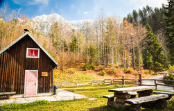 Alpine hut with a bench Stock Image