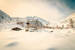 Alpine hut covered by the snow Stock Images