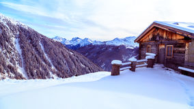 Alpine hut covered by the snow Royalty Free Stock Photos