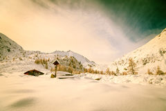 Alpine hut covered by the snow Royalty Free Stock Images