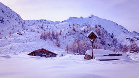 Alpine hut covered by the snow Royalty Free Stock Photography