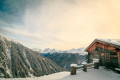 Alpine hut covered by the snow Stock Photo