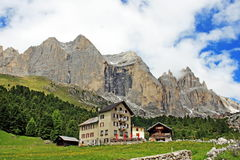 Alpine hut at the foot of the mountain Royalty Free Stock Photography