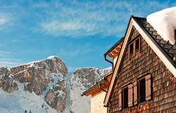 Alpine hut in front of a mountain peak in winter Stock Photography