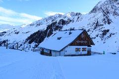 Alpine hut Potsdamer Hutte and mountain panorama with snow in winter in Stubai Alps Royalty Free Stock Photos